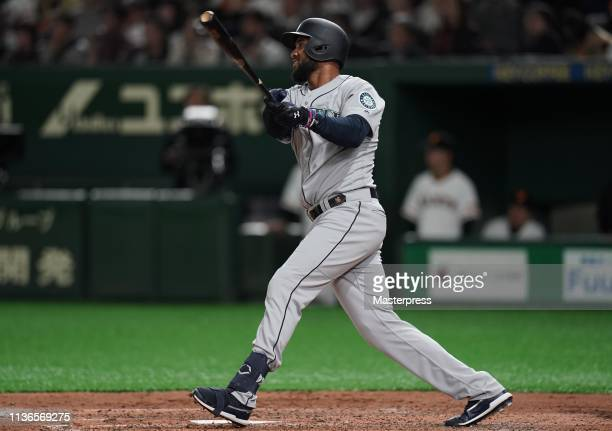 Outfielder Domingo Santana of the Seattle Mariners hits a single in the top of 4th inning during the preseason friendly game between Yomiuri Giants...