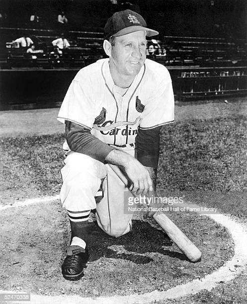 Outfielder Enos Slaughter of the St Louis Cardinals poses for a portrait in the on deck circle Enos Bradsher Slaughter played for the St Louis...