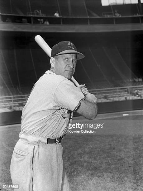 Outfielder Enos Slaughter of the St Louis Cardinals poses for portrait prior to a 1951 season game against the New York Giants at the Polo Grounds in...