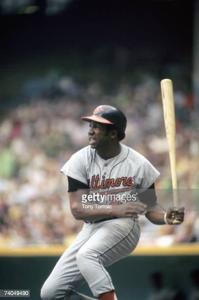 Outfielder Frank Robinson of the Baltimore Orioles watches the ball he's just hit during a game in July 1971 against the Cleveland Indians at...