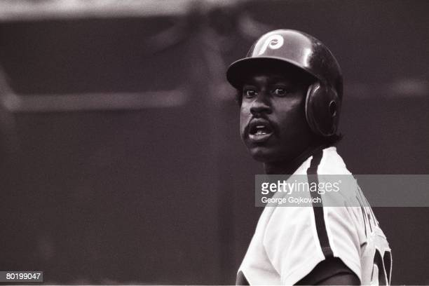 Outfielder Gary Matthews of the Philadelphia Phillies looks up at the scoreboard while waiting to bat against the Pittsburgh Pirates during a game at...
