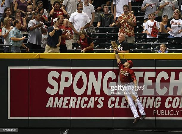 Outfielder Gerardo Parra of the Arizona Diamondbacks attempts to catch a solo home run hit by Chris Burke of the San Diego Padres during the eighth...