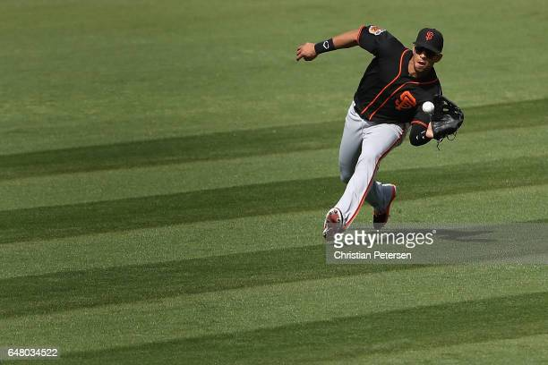 Outfielder Gorkys Hernandez of the San Francisco Giants makes a running catch for an out against the Kansas City Royals during the fourth inning of...