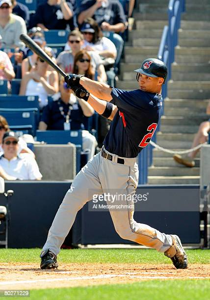 Outfielder Grady Sizemore of the Cleveland Indians follows through on his second home run against the New York Yankees March 16 2008 at Legends Field...