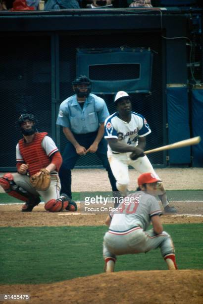 Outfielder Hank Aaron of the Atlanta Braves hammers a pitch from the St Louis Cardinals Rick Wise during a circa 1970s game at AtlantaFulton County...