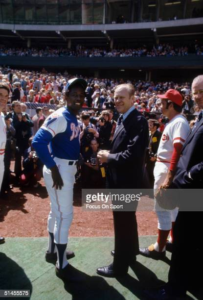 Outfielder Hank Aaron of the Atlanta Braves talks with President Gerald Ford during a circa 1970s game against the Cincinnati Reds at Riverfront...