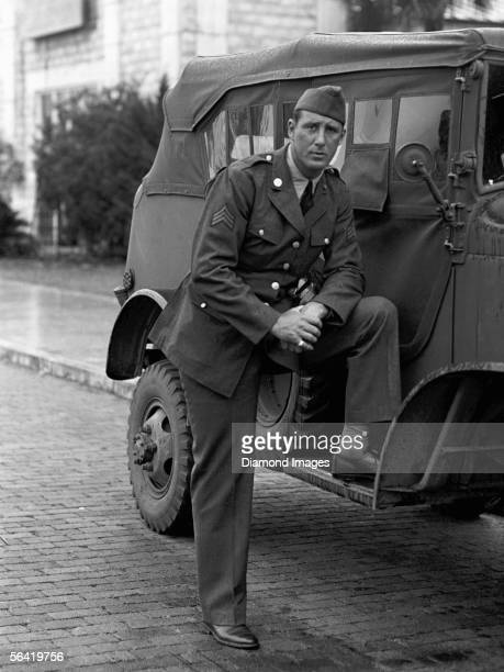Outfielder Hank Greenberg of the Detroit Tigers poses in his army uniform next to a Jeep after he enlisted in the service to support the United...