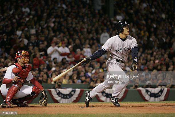 Outfielder Hideki Matsui of the New York Yankees hits a two run home run in the first inning during game three of the ALCS against the Boston Red Sox...