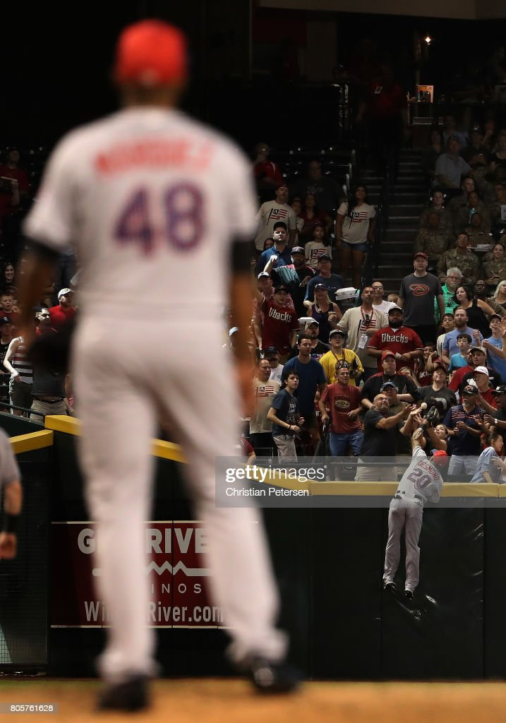 Outfielder Ian Desmond #20 of the Colorado Rockies is unable to catch a home run ball hit by Chris Owings (not pictured) of the Arizona Diamondbacks during the fourth inning of the MLB game at Chase Field on July 2, 2017 in Phoenix, Arizona.