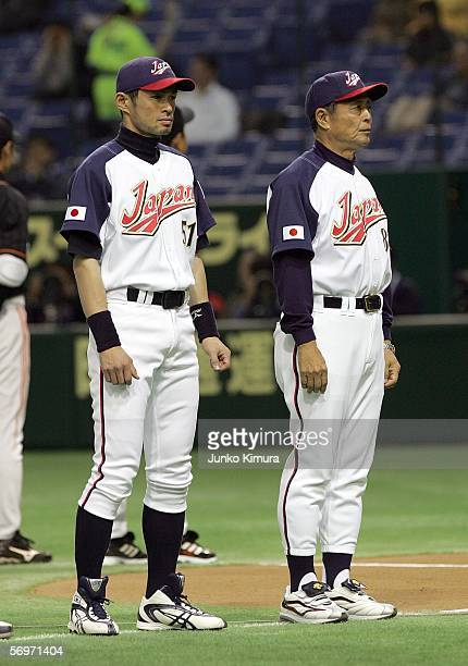 Outfielder Ichiro Suzuki and team manager Sadaharu Oh of Japan line up at the start of the 2006 World Baseball Classic Exhibition Game against the...
