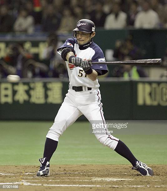 Outfielder Ichiro Suzuki of Japan watches the ball during the first round match between Japan and Korea of the 2006 World Baseball Classic at the...