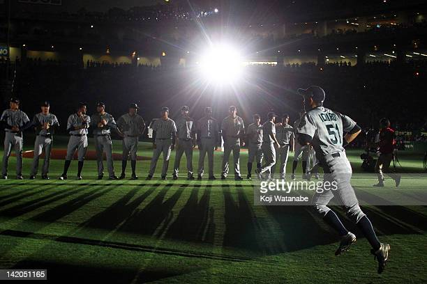Outfielder Ichiro Suzuki of Seattle Mariners runs to line up for national anthem during MLB match between Seattle Mariners and Oakland Athletics at...