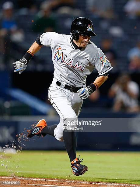 Outfielder Ichiro Suzuki of the Miami Marlins runs to first base in the eighth inning during the game against the Atlanta Braves at Turner Field on...