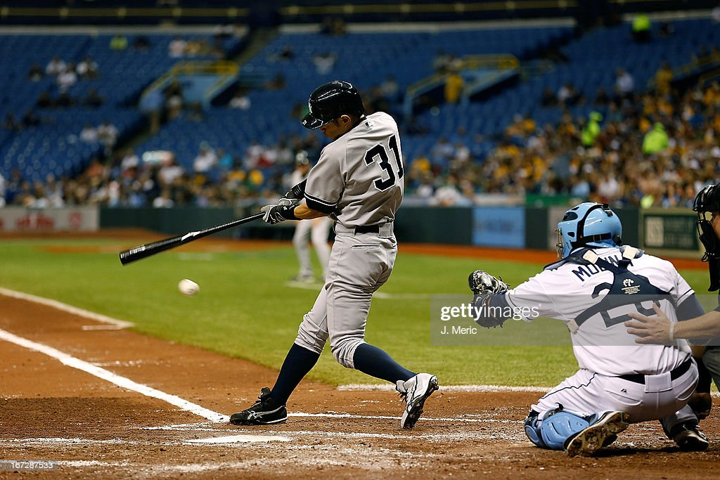 Outfielder Ichiro Suzuki #31 of the New York Yankees fouls off a pitch against the Tampa Bay Rays during the game at Tropicana Field on April 23, 2013 in St. Petersburg, Florida.
