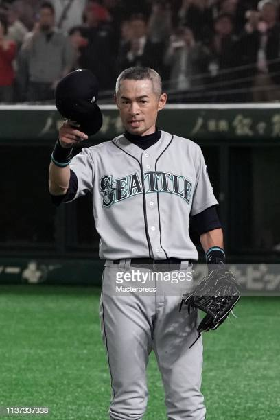 Outfielder Ichiro Suzuki of the Seattle Mariners applauds fans as he is substituted to retire from baseball during the game between Seattle Mariners...