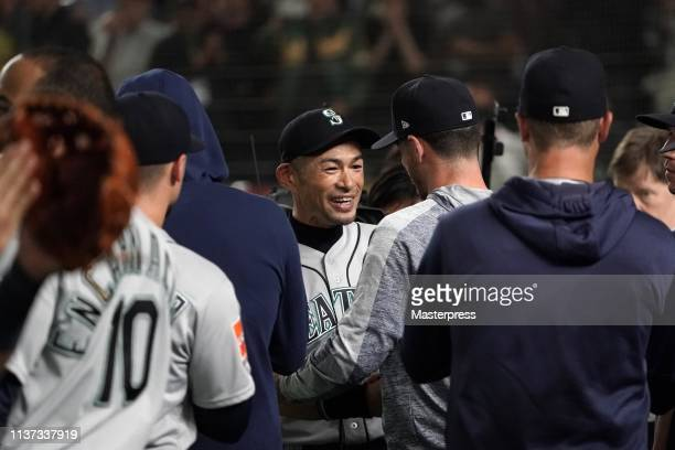 Outfielder Ichiro Suzuki of the Seattle Mariners is embraced by his team mates and staffs as he is substituted to retire from baseball in the 8th...