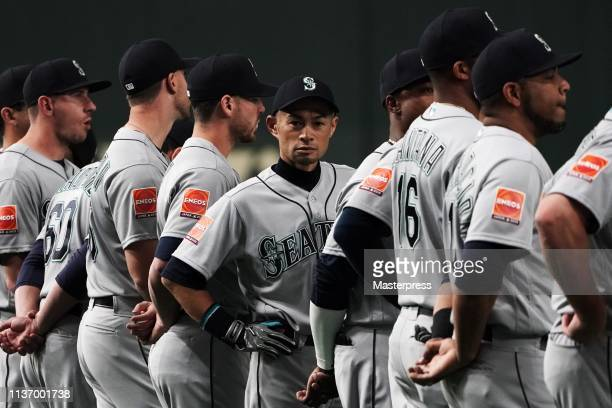 Outfielder Ichiro Suzuki of the Seattle Mariners is seen as players line up for the national anthems prior to the game between Seattle Mariners and...