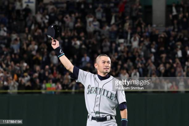 Outfielder Ichiro Suzuki of the Seattle Mariners laps the stadium to applaud fans after the game between Seattle Mariners and Oakland Athletics at...