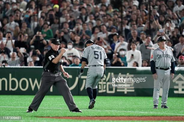 Outfielder Ichiro Suzuki of the Seattle Mariners reacts after a ground out in the 8th inning last plate appearance during the game between Seattle...