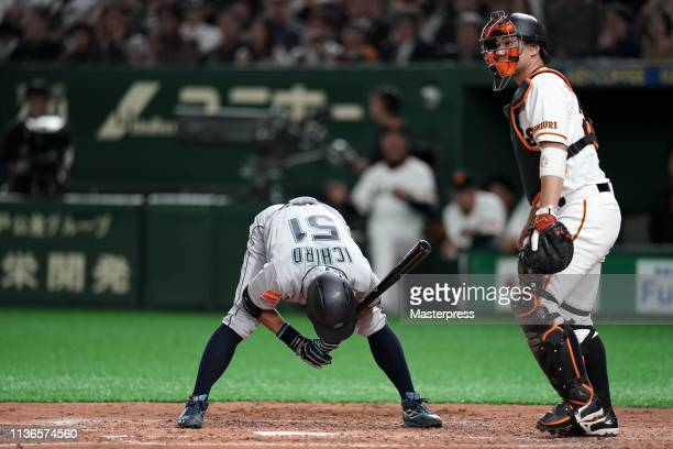 Outfielder Ichiro Suzuki of the Seattle Mariners reacts after strike out in the top of 4th inning during the preseason friendly game between Yomiuri...