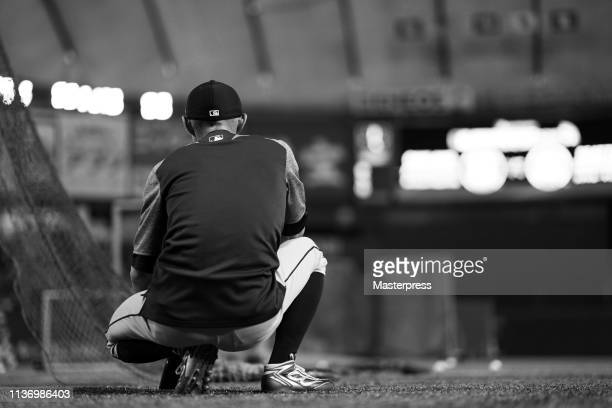 Outfielder Ichiro Suzuki of the Seattle Mariners warms up prior to the game between Seattle Mariners and Oakland Athletics at Tokyo Dome on March 20...