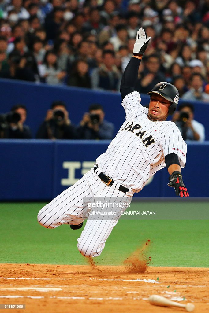 Outfielder Ikuhiro Kiyota #1 of Japan slides safely into the home plate to make 0-2 by the two run double by catcher Yuhei Nakamura #52 during the international friendly match between Japan and Chinese Taipei at the Nagoya Dome on March 5, 2016 in Nagoya, Aichi, Japan.
