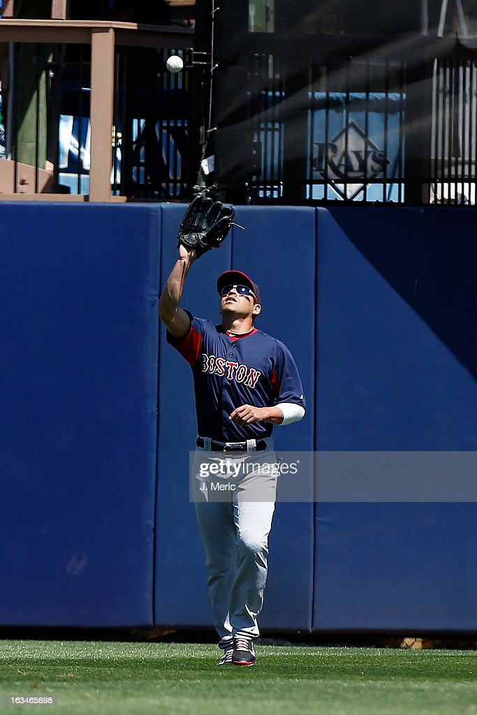 Outfielder Jacoby Ellsbury #2 of the Boston Red Sox catches a fly ball against the Tampa Bay Rays during a Grapefruit League Spring Training Game at the Charlotte Sports Complex on March 10, 2013 in Port Charlotte, Florida.
