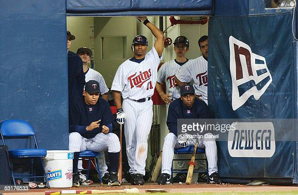 Outfielder Jacque Jones and the rest of the Minnesota Twins watch game four of the American League Divisional Series against the New York Yankees at...