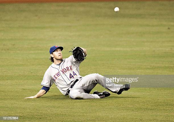 Outfielder Jason Bay of the New York Mets cannot make the catch against the Miami Marlins at Marlins Park on September 2 2012 in Miami Florida