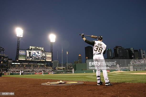 Outfielder Jason Bay of the Pittsburgh Pirates, with the scoreboard and downtown Pittsburgh skyline in the background, takes a practice swing while...
