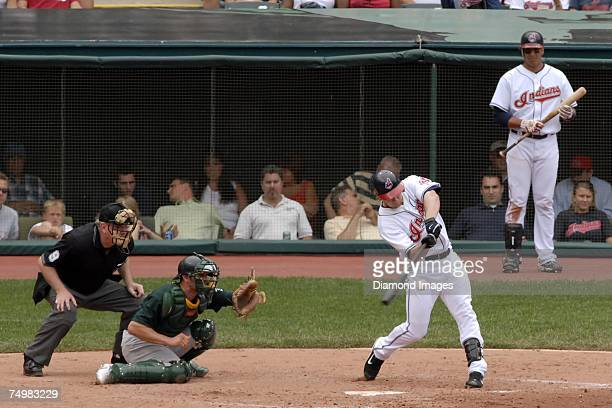 Outfielder Jason Michaels hits a fly ball to centerfield to end the fifth inning as catcher Jason Kendall, umpire Brian Gorman, and Victor Martinez...