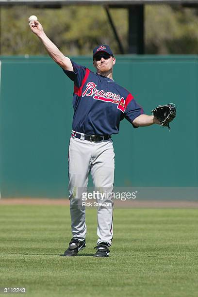 Outfielder JD Drew of the Atlanta Braves throws the ball towards the infield during a spring training game against the Houston Astros at Osceola...