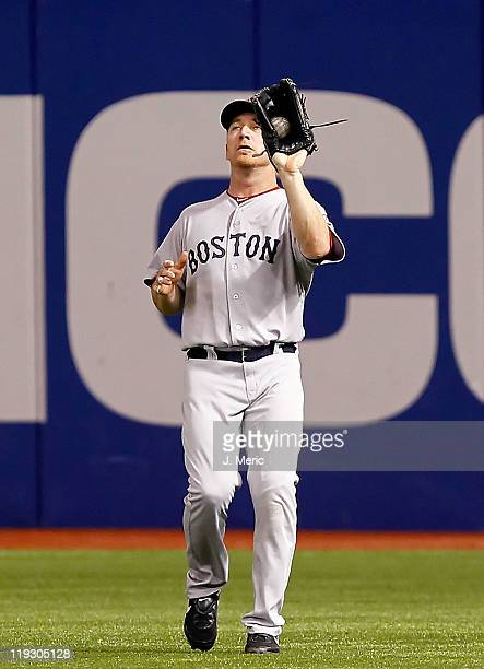 Outfielder JD Drew of the Boston Red Sox catches a fly ball against the Tampa Bay Rays during the game at Tropicana Field on July 17 2011 in St...