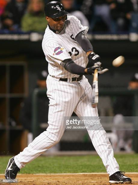 Outfielder Jermaine Dye of the Chicago White Sox hits a solo home run against the Houston Astros during the first inning of Game One of the 2005...