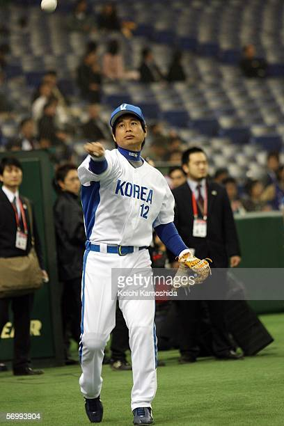 Outfielder Ji Man Song of Korea practices before playing at the first round of the 2006 World Baseball Classic at the Tokyo Dome on March 4, 2006 in...