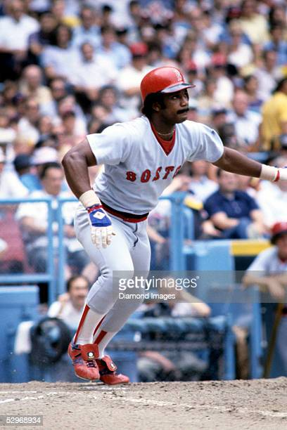 Outfielder Jim Rice of the Boston Red Sox follows the flight of the ball he's just hit during a game in July 1978 against the Cleveland Indians at...