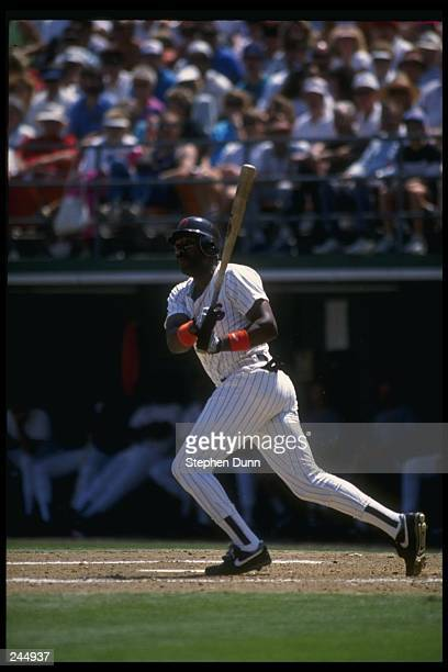 Outfielder Joe Carter of the San Diego Padres swings at the ball during a game at Jack Murphy Stadium in San Diego California Mandatory Credit...
