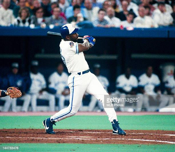 Outfielder Joe Carter of the Toronto Blue Jays bats during Game Four of the 1992 World Series against the Atlanta Braves at the Skydome on October 21...
