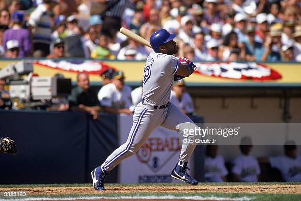Outfielder Joe Carter of the Toronto Blue Jays swings during game 3 of the American League Championship Series against the Oakland A's on October 10...