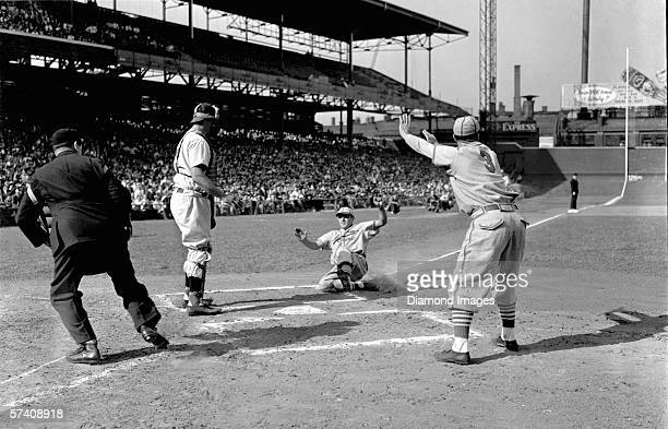Outfielder Joe Medwick of the St Louis Cardinals slides home with a run in the second inning of a game on September 27 1939 against the Cincinnati...