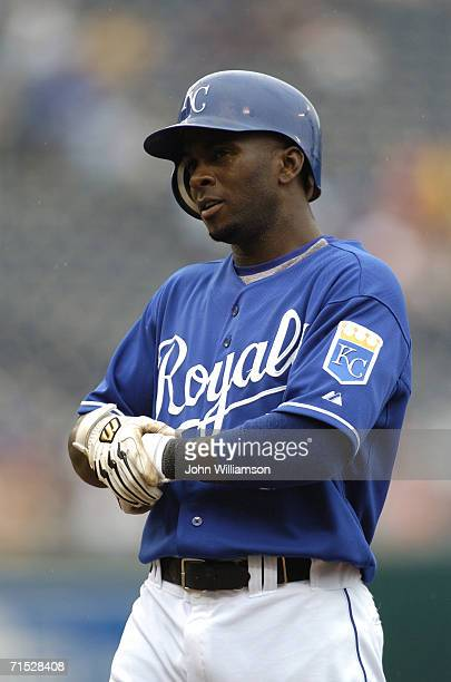 Outfielder Joey Gathright of the Kansas City Royals look to the first base coach after reaching base safely during the game against the Toronto Blue...