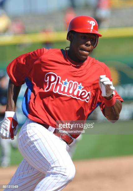Outfielder John Mayberry Jr. Of the Philadelphia Phillies rounds third base against the Toronto Blue Jays February 26, 2009 at Bright House Field in...