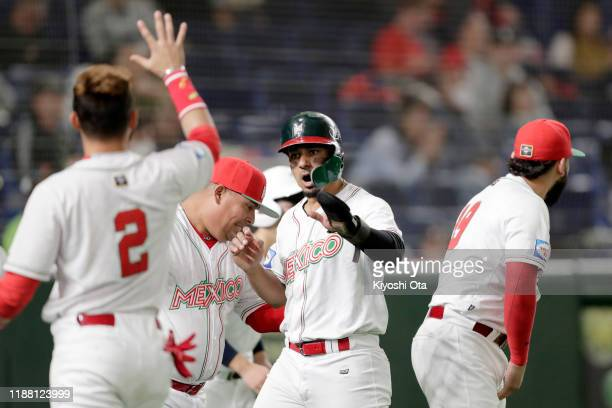 Outfielder Jonathan Jones of Mexico celebrates after scoring a run by a RBI single of Designated hitter Matthew Clark in the bottom of 6th inning...