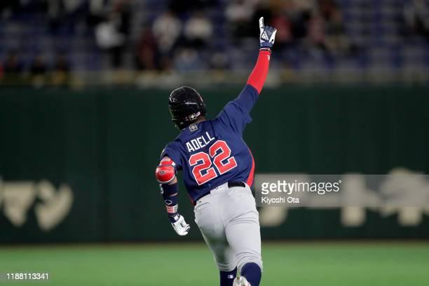 Outfielder Jordon Adell of the United States celebrates hitting a solo home in the top of 1st inning during the WBSC Premier 12 Bronze Medal final...