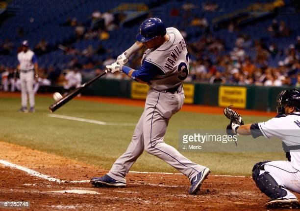 Outfielder Josh Hamilton of the Texas Rangers hits a grand slam home run against of the Tampa Bay Rays during the eighth inning of the game on May 27...