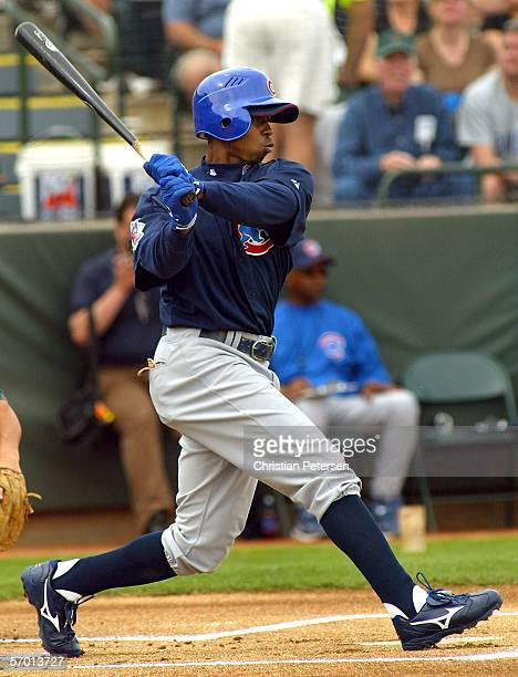 Outfielder Juan Pierre of the Chicago Cubs bats against the Oakland Athletics during a Spring Training game on March 6 2006 at the Phoenix Municipal...