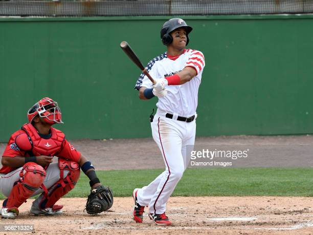 Outfielder Juan Soto of the Potomac Nationals, single-A affiliate of the Washington Nationals, hits a solo homerun during the bottom of the third...