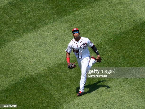 Outfielder Juan Soto of the Washington Nationals catches a fly ball off the bat of outfielder Billy Hamilton of the Cincinnati Reds in the third...