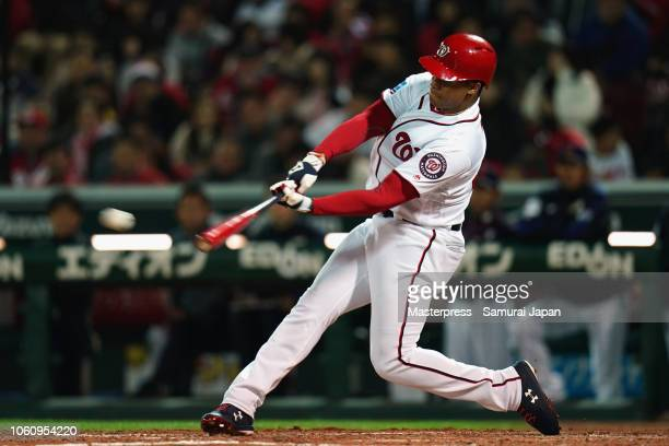 Outfielder Juan Soto of the Washington Nationals hits a RBI double to make it 20 in the bottom of 7th inning during the game four between Japan and...