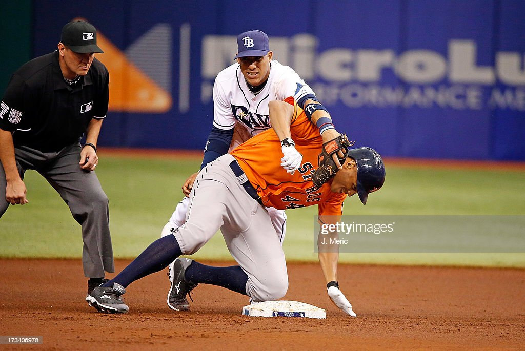 Outfielder Justin Maxwell #44 of the Houston Astros is safe at second base after his double as shortstop Yunel Escobar #11 of the Tampa Bay Rays cannot handle the throw during the game at Tropicana Field on July 13, 2013 in St. Petersburg, Florida.